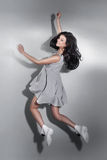 Smiling beautiful brunette woman jumping. Royalty Free Stock Photography