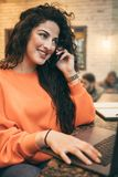 Smiling business woman communicates by phone friendly Stock Images