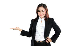 Smiling beautiful business woman presenting blank area Royalty Free Stock Images