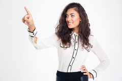 Smiling beautiful businesswoman pointing finger away Royalty Free Stock Images