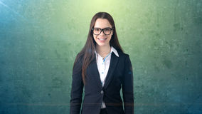 Smiling beautiful businesswoman portrait, green background Royalty Free Stock Image