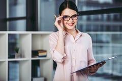 Businesswoman holding clipboard stock photos