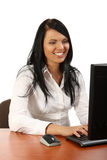 Smiling beautiful businesswoman working in office Royalty Free Stock Images
