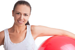 Smiling beautiful caucasian girl with red fitball Royalty Free Stock Photo