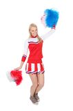 Smiling beautiful cheerleader with pompoms. Stock Images