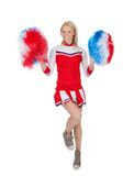 Smiling beautiful cheerleader with pompoms. Royalty Free Stock Photos