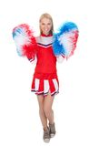 Smiling beautiful cheerleader with pompoms. Stock Photos