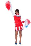 Smiling beautiful cheerleader with pompoms Royalty Free Stock Photo