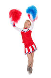 Smiling beautiful cheerleader with pompoms. Royalty Free Stock Image