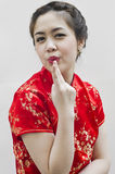Smiling beautiful chinese young woman gesturing Stock Photography