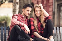 Smiling beautiful couple dating outdoors. Smiling couple in love dating outdoors.Young happy couple hugging on the city street stock image
