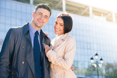 Smiling beautiful couple hugging outdoors Royalty Free Stock Image
