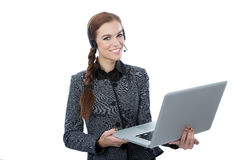 Smiling beautiful customer service worker. Portrait of a beautiful service customer worker holding a laptop. White background. Beautiful smile Stock Photos
