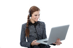 Smiling beautiful customer service worker holding a laptop. Portrait of a beautiful service customer worker holding a laptop. White background. Beautiful smile Royalty Free Stock Photo