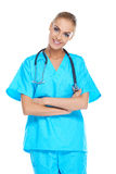 Smiling beautiful doctor in scrubs Royalty Free Stock Photo