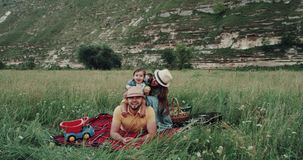 Smiling beautiful family at the picnic playing , in the middle of mountain stock footage