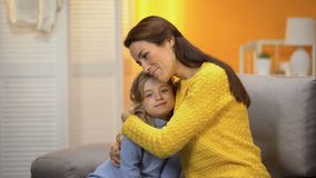 Smiling beautiful female hugging tenderly happy preschool daughter, trust. Stock footage stock footage