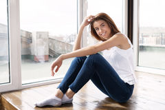 Smiling beautiful girl in blue jeans Stock Photo