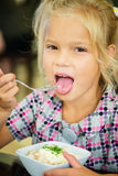 Smiling beautiful girl with bowl of salad Royalty Free Stock Images