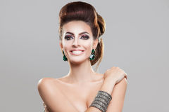 Smiling Beautiful girl brown hair with an elegant hairstyle stock photo