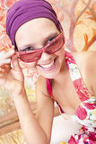 Smiling beautiful girl with colored nails. Smiling beautiful caucasian girl  with hands which has colored nails holds her sunglasses Stock Photography