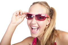 Smiling beautiful girl with colored nails. Smiling beautiful caucasian girl  with hands which has colored nails holds her sunglasses Royalty Free Stock Photography