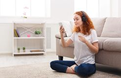 Happy girl listening to music in headphones Royalty Free Stock Image