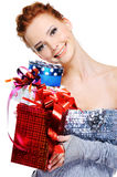 Smiling beautiful girl with gift boxes in hands Stock Photo