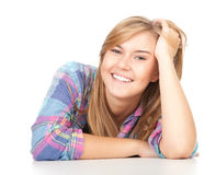 Smiling beautiful girl leaning on the table Royalty Free Stock Photos