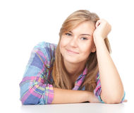 Smiling beautiful girl leaning on the table Stock Photography