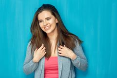 Smiling beautiful girl with long hair. Portrait on blue wall background Stock Photo