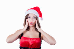 Smiling beautiful girl with Santa hat touching Royalty Free Stock Photo