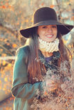Smiling beautiful girl in sunset light. Beautiful young woman portrait in warm sunset light . Model is smiling Royalty Free Stock Image