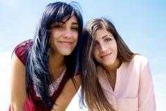 Smiling beautiful girls looking camera royalty free stock images