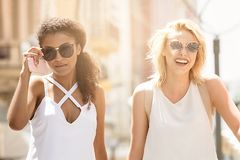 Smiling beautiful girls on summer vacation. royalty free stock image