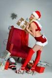 Smiling beautiful happy girl dressed as Sexy Santa Helper Stock Photo