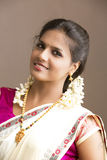 Smiling Beautiful Indian girl in traditional Indian half sari Stock Images