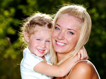 Smiling and beautiful mother and little daughter Royalty Free Stock Photo