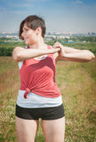 Smiling beautiful plus size woman in sportswear doing exercise Stock Images