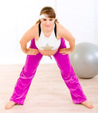 Smiling beautiful pregnant woman doing exercise Stock Photo
