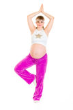 Smiling beautiful pregnant woman doing yoga Royalty Free Stock Image