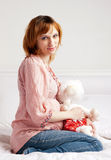 The smiling beautiful pregnant woman with a plush toy Stock Images