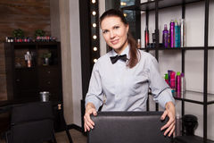 Smiling beautiful professional  standing near the Royalty Free Stock Image