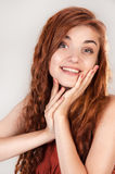 Smiling beautiful red haired girl Royalty Free Stock Photos