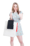 Smiling beautiful shopper doing double like gesture Royalty Free Stock Photo