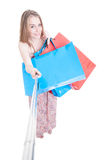 Smiling beautiful shopper doing shopping and taking a selfie Royalty Free Stock Photo