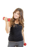 Smiling beautiful sporty fit athletic girl with weights or red d royalty free stock image