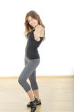 Smiling beautiful sporty fit athletic girl or woman with thumb u royalty free stock photography