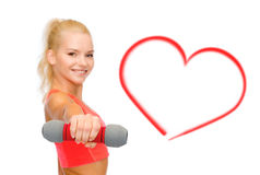 Smiling beautiful sporty woman with dumbbell Stock Images