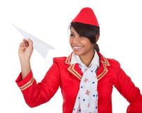 Smiling beautiful stewardess launching a place Royalty Free Stock Photos